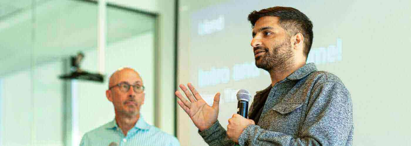 Blend CEO Nima Ghamsari speaks with President Tim Mayapoulos in background
